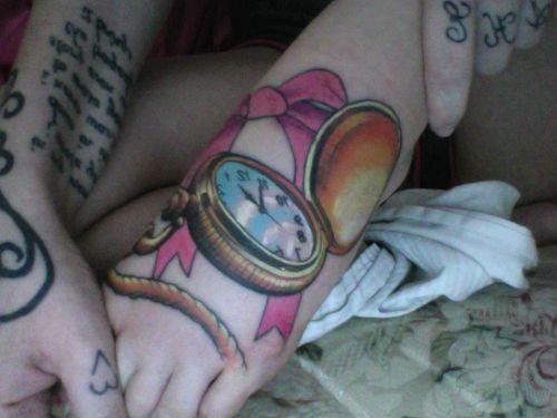 Pink clock tattoo