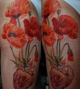 Poppy flowers photorealistic tattoo