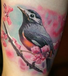 Pretty bird photorealistic tattoo