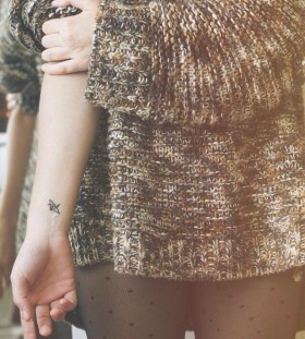 Pretty origami tattoo