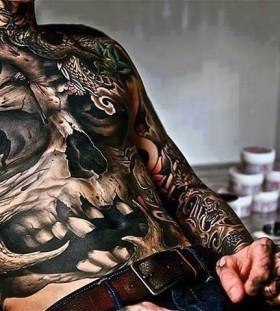 Realistic chest tattoo
