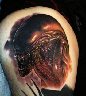 Scary man alien tattoo