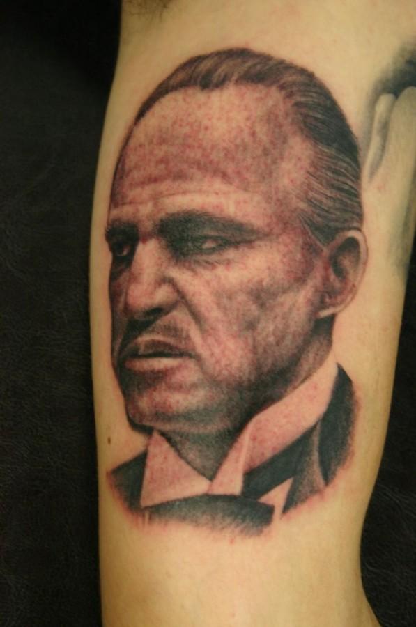 Serious man tattoo by Corey Miller