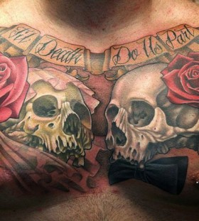 Skulls and red roses chest tattoo