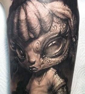 Woman alien tattoo