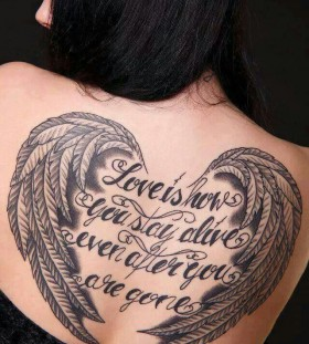 Woman back angel wings tattoo