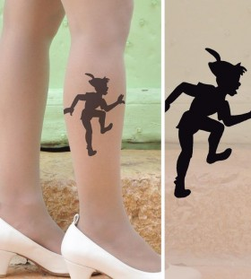 Woman leg Peter Pan tattoo