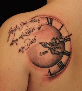 Words and clock tattoo
