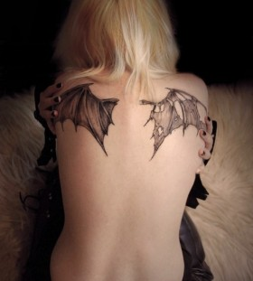 black bat wings tattoo