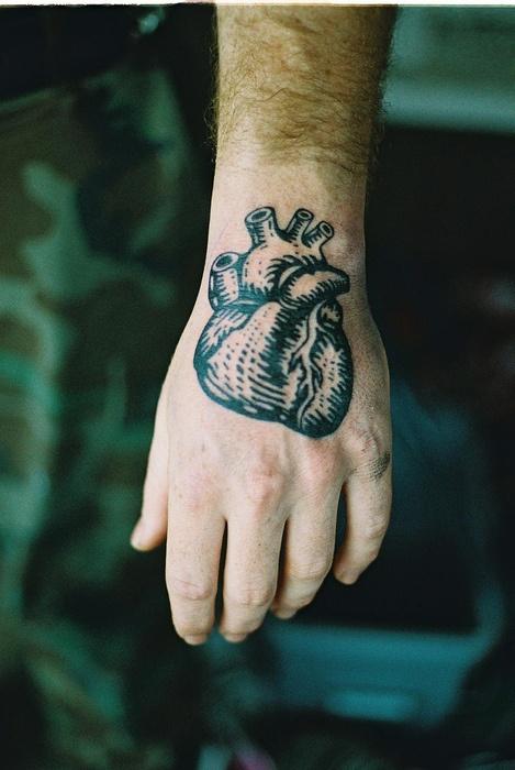 black heart tattoo for man