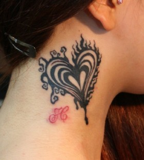 black heart tattoo on the neck