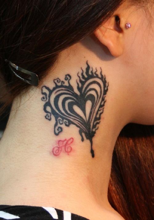 black heart tattoo on the neck