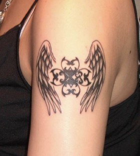 black wings tattoo arm