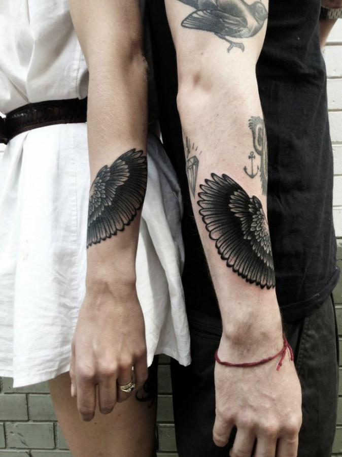 black wings tattoo couple
