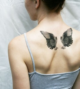 black wings tattoo small angel