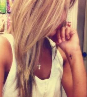cross tattoo blondie