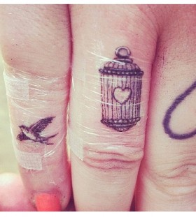 finger tattoo bird cage