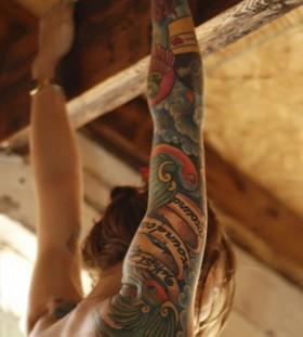 hand tattoo hanging girl