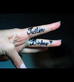 justin bieber tattoo on the fingers