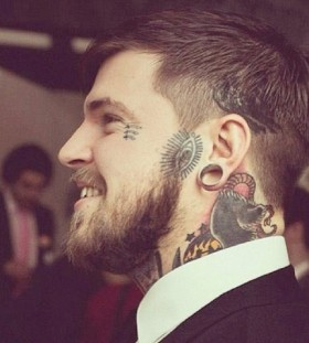 man with cool face tattoos
