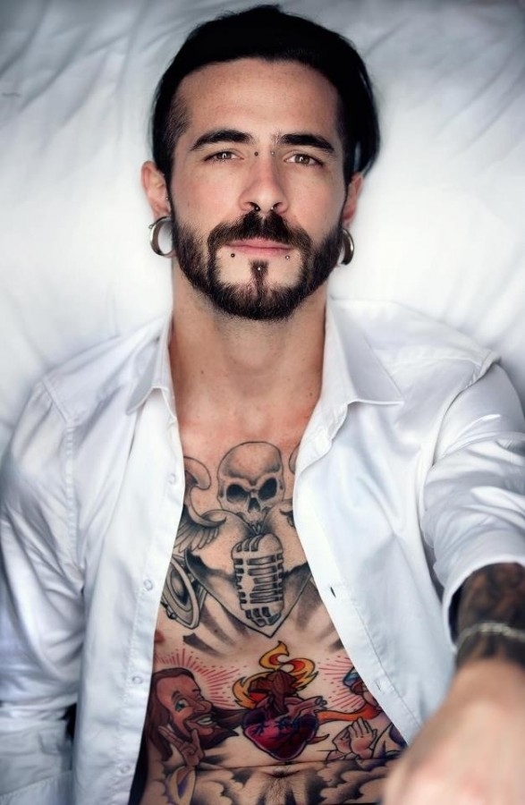 man with tattoos heart