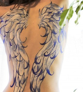 painted wings on back tattoo