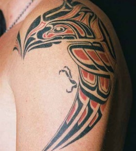 red tribal tattoo bird