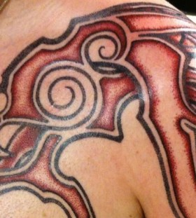 red tribal tattoo ink