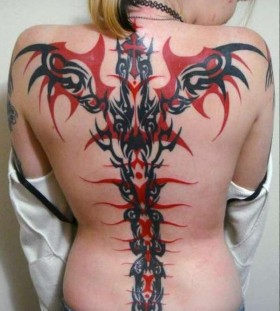 red tribal tattoo spine