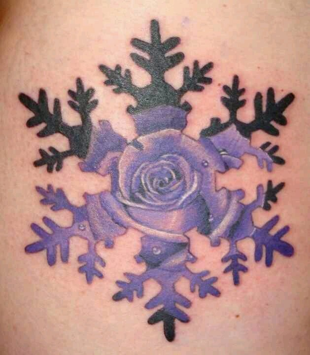 small purple snowflake tattoo