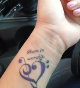 small purple tattoo born to