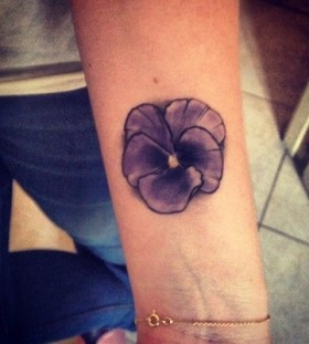 small purple tattoo flower