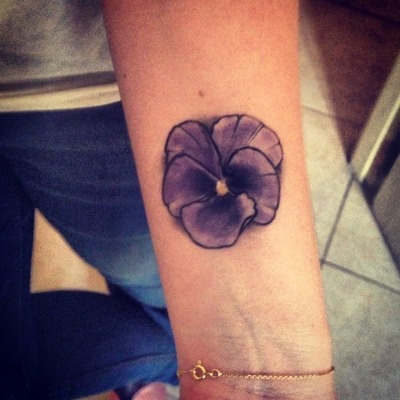 small purple tattoo flower