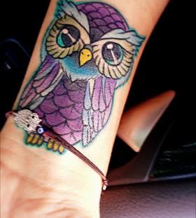 small purple tattoo owl