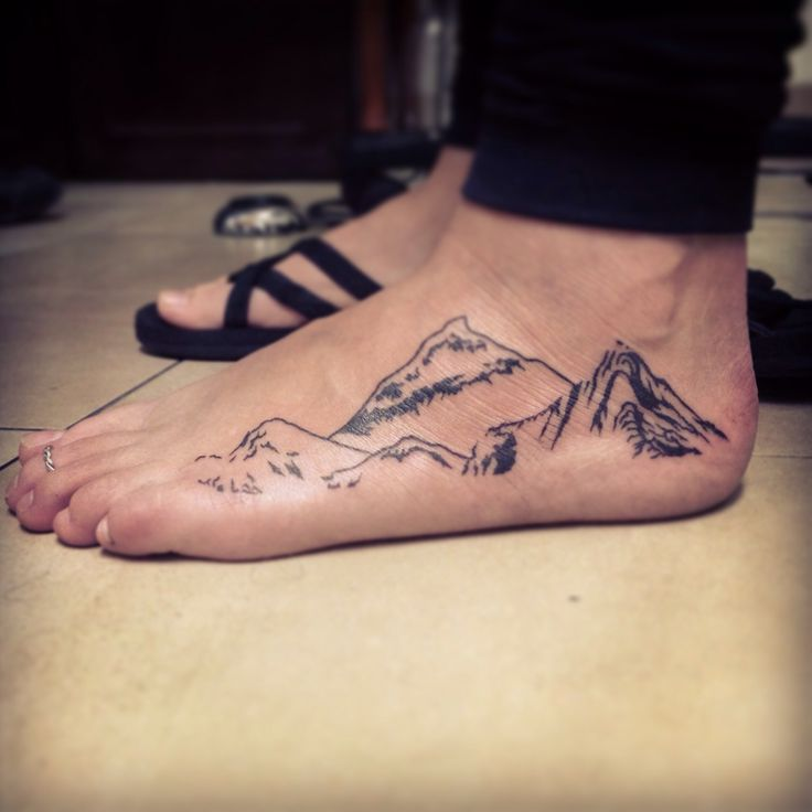 Amaizing foot mountains tattoo