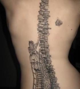 Amazing books tower tattoo