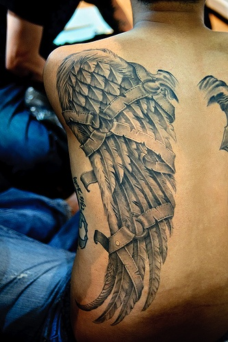 Amazing broken wing tattoo