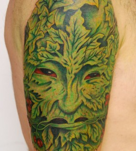 Amazing green face tattoo