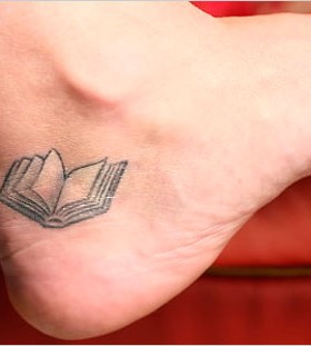 Awesome small book tattoo
