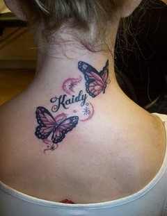 Beautiful tattoo with butterfly on the back
