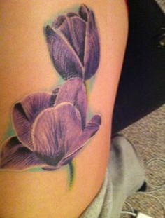 Beautiful tattoo with purple tulips