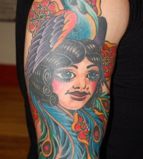 Bird and girl tattoo by Mike Schweigert