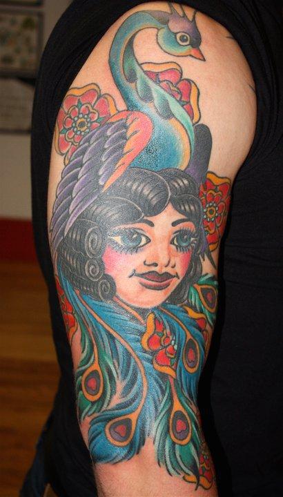 Bird and girl tattoo by Mike Schweigert