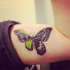 Black & green butterfly on muscle
