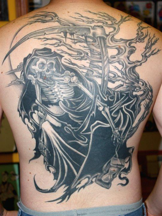 Black tattoo by Mike Schweigert