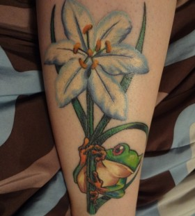 Blue flower and frog tattoo
