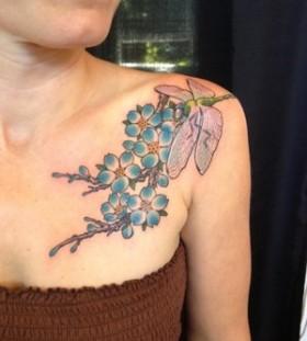 Blue flowers tattoo by Miah Waska