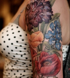 Colorful flowers tattoo by Alice Carrier