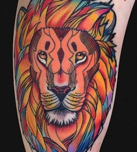Colorful lion tattoo by Art Junkies