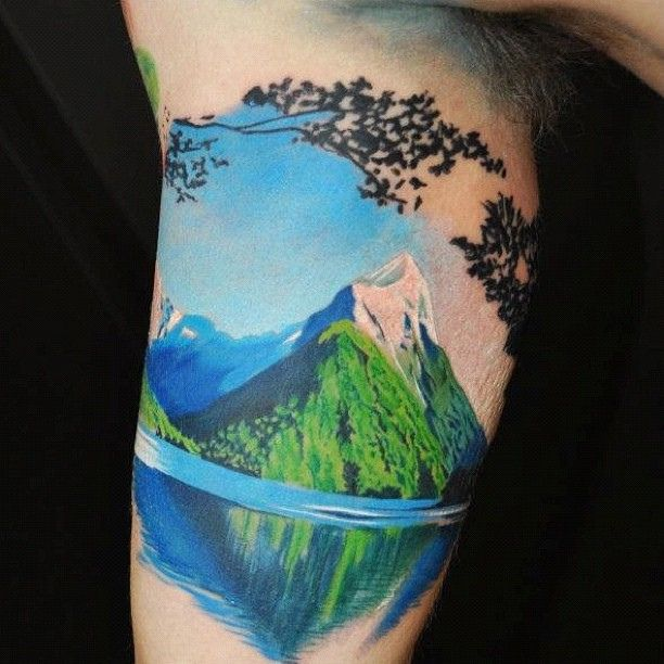 Colorful mountains tattoo